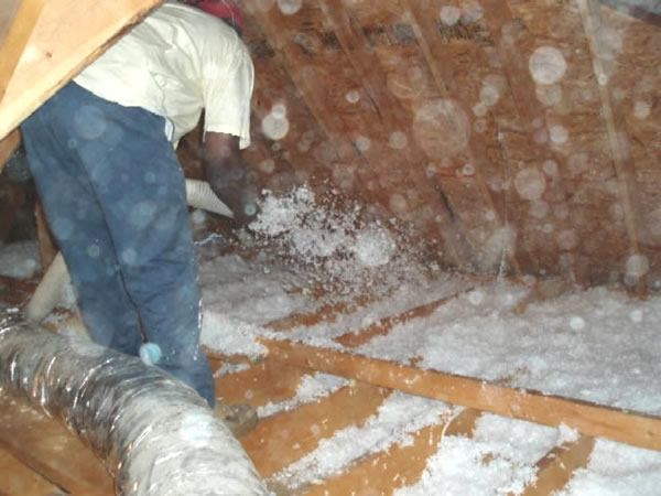 Insulation being installed in an attic in Georgia